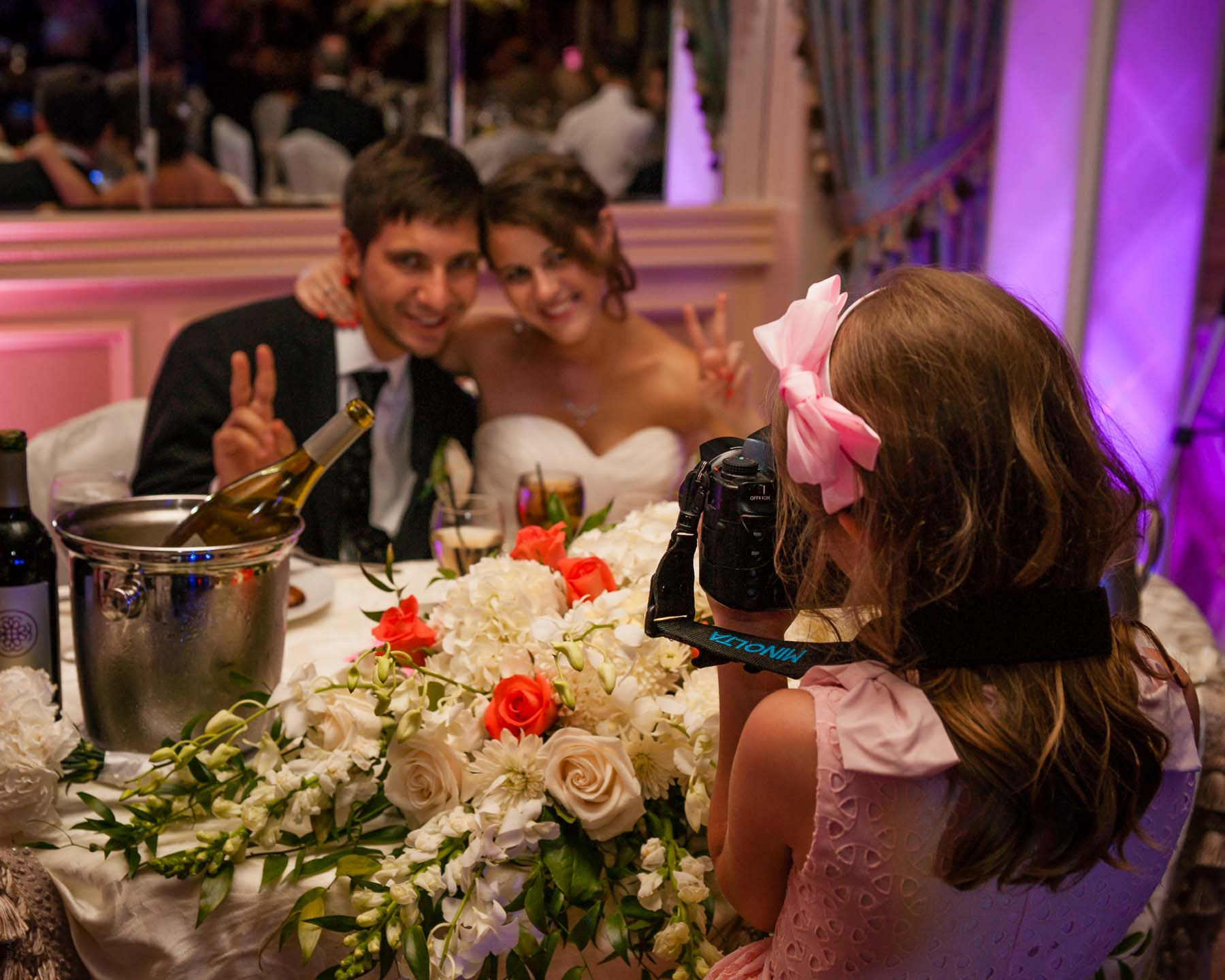 7 year old girl photographs the happy couple at a wedding with a full-frame DSLR Sony A900